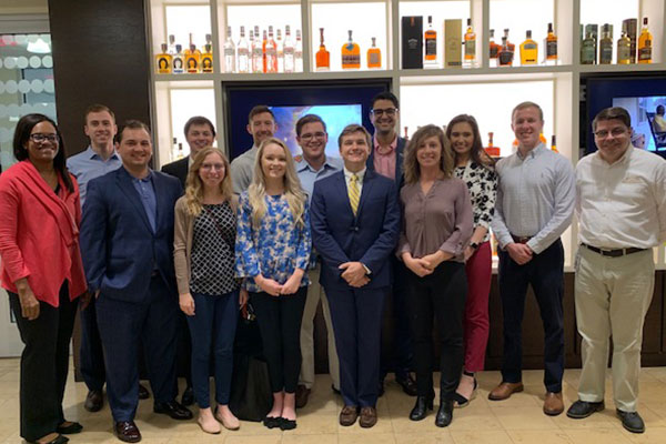 Jaileah X. Huddleston, VP, Assistant General Counsel and Assistant Corporate Secretary at Brown-Forman, left, and Louisville Law M&A students.