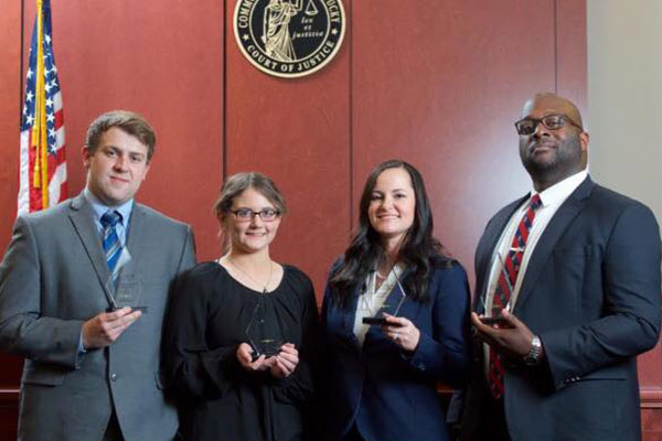 From left, Will Razor, Jessica Harper, Erica Sherrard and James Wilkerson with their finalist trophies.