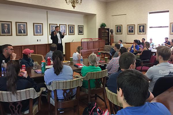Professor Stephen Vladeck addresses a full room at Louisville Law.