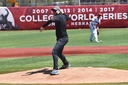 Professor Justin Walker throws out the first pitch.