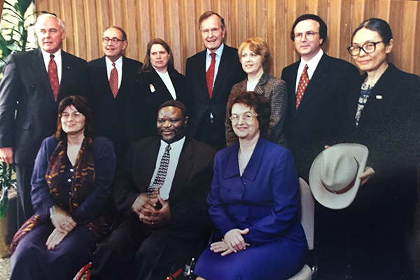 Professor Laura Rothstein is to the right of President George H.W. Bush. In this 2000 photo, they're celebrating the 10th anniversary of the ADA.