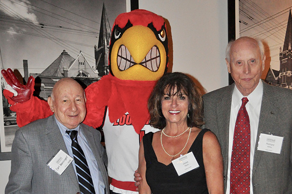 Alumni mingle with Louie, the Cardinal bird