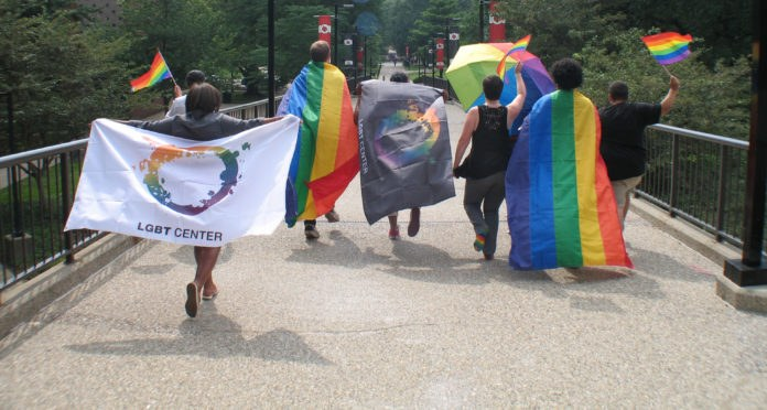 students walking with rainbow flags