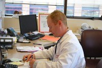 Dr. Tatum reading lab results