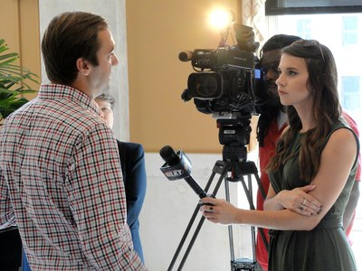 News reporters interview Dr. Bolli