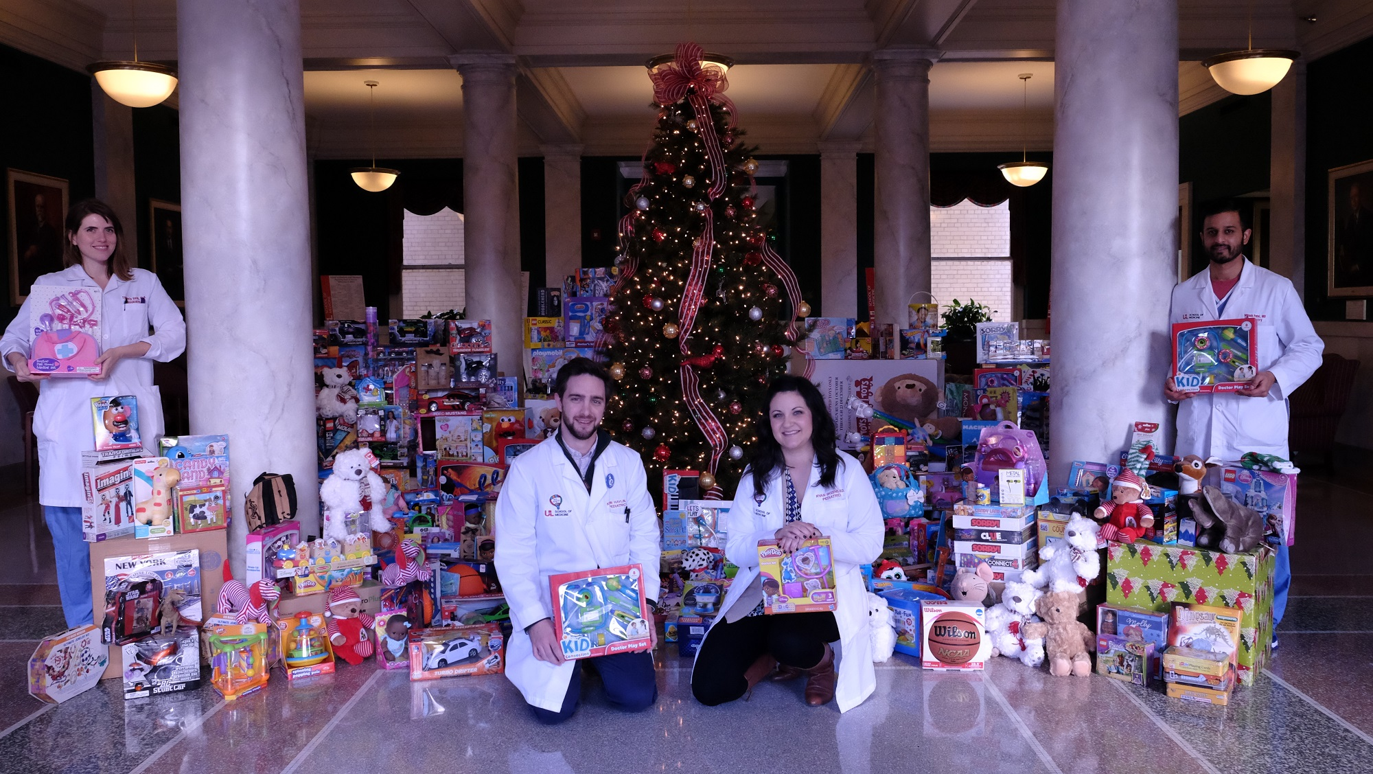 Residents with toys for Toy Drive
