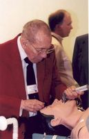 Dr. Paris with a mannequin used to train medical students