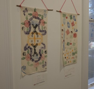 Two of the students' scrolls on display