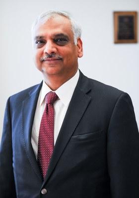 Aruni Bhatnagar Ph.D. suit and tie