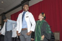 Future doctors receive their first white coat at UofL