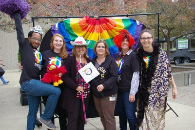 [Six of the 500 student and staff attendees enjoy the 2016 HSC Pride Week Cookout]