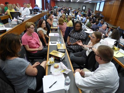 [Participants in the 2015 LGBTQ Health Summit discuss best practices for the care of transgender patients]