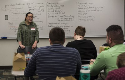 [Volunteers preparing to be guest speakers in a medical school class]