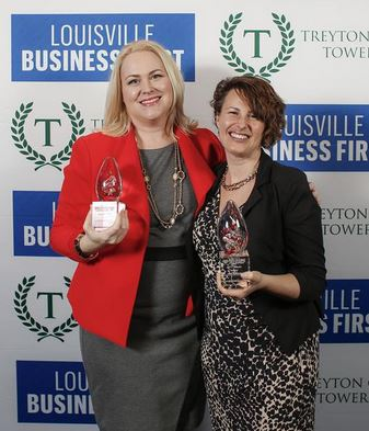 "[Caption: Amy Holthouser, M.D., and Stacie Steinbock receive ""Best Innovators"" award for UofL's eQuality Project from Louisville Business First, February 2017] [hyperlink Best Innovators with: http://louisville.edu/medicine/news/uofl-educators-honored-by-louisville-business-first-for-preparing-future-physicians-to-care-for-lgbtq-patients]"