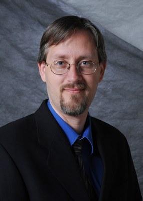 Portrait of Dr. Shamus McNamara, Associate Director of the UofL Micro/NanoTechnology Cleanroom and Associate Professor of ECE.