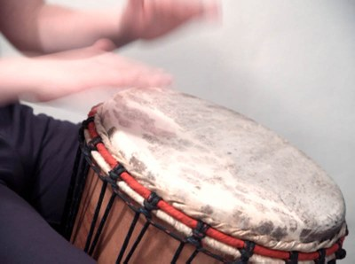 Closeup of musician playing a drum