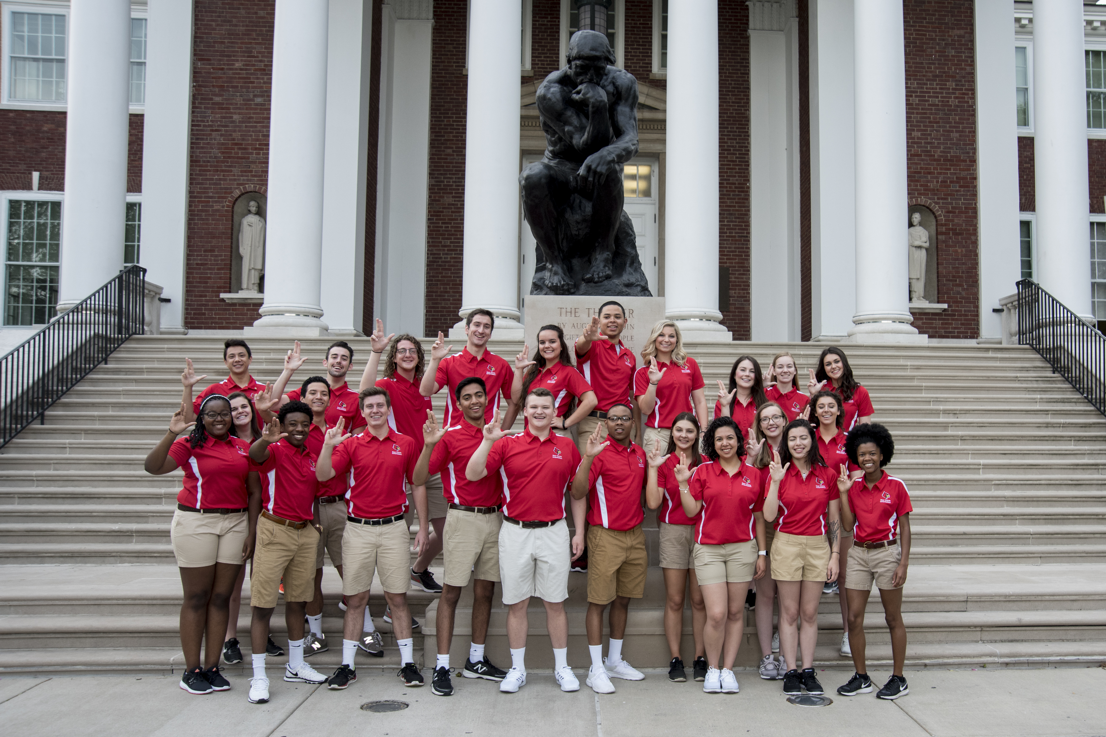 A photo of all the SOSers in front of the Thinker sculpture on UofL's campus.
