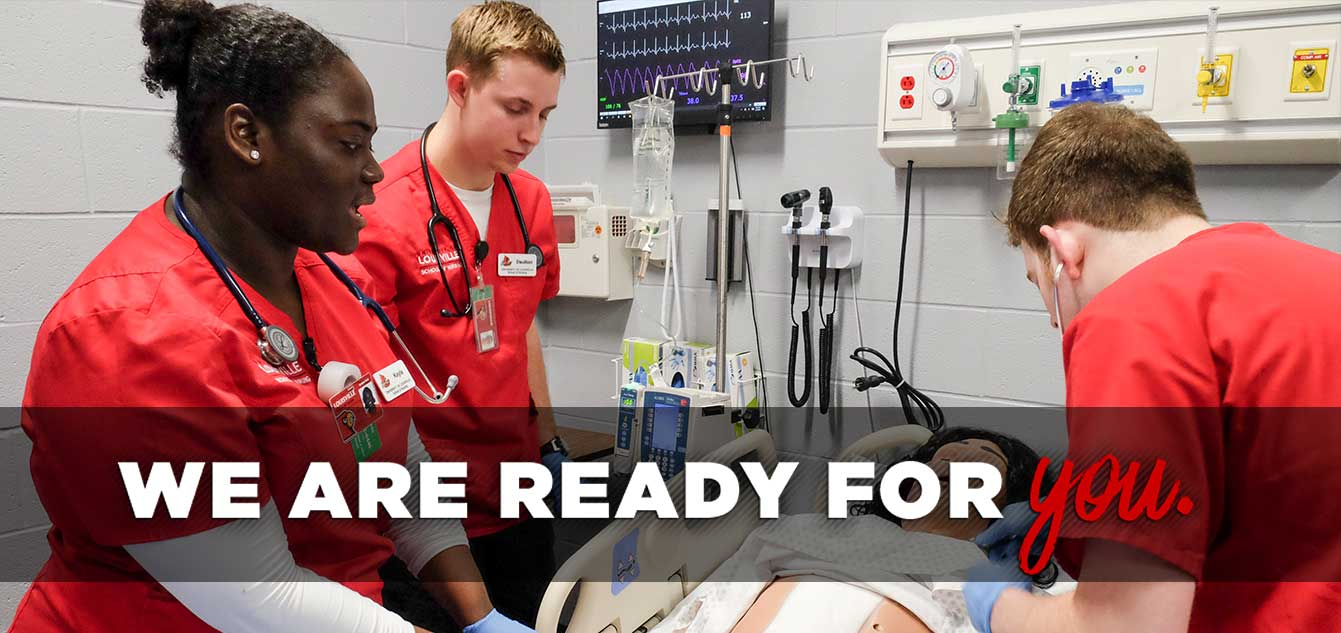 Photo of three nursing students in a simulation lab with a mannequin with overlay that reads 'We are ready for you.'