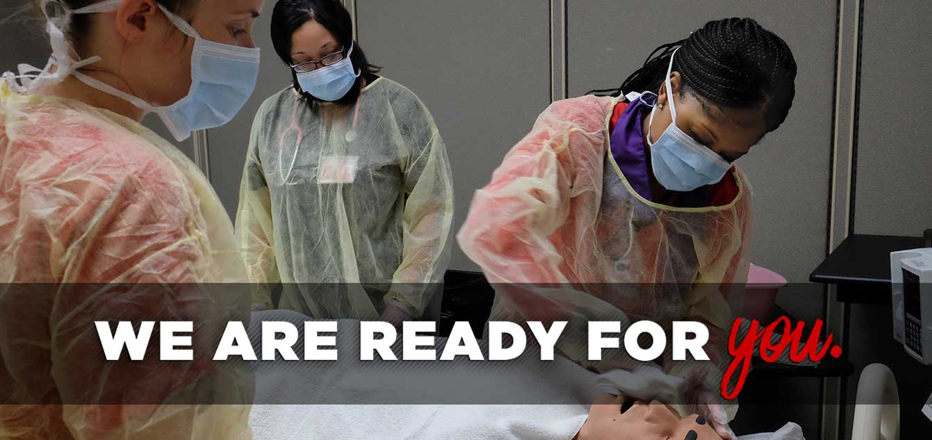 Photo of two nrusing students in a simulation lab with a mannequin overseen by faculty with overlay that reads 'We are ready for you.'