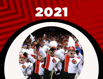 2021 calendar cover with a photo of the uofl marching band