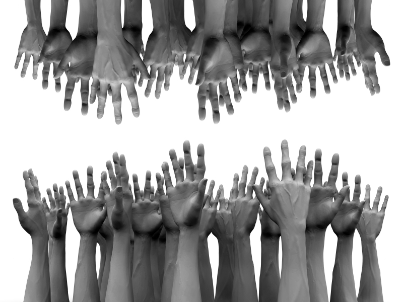 many hands reaching out to each other
