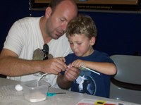 Father and son work on an experiment together