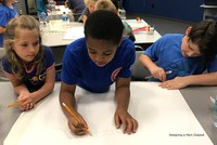 Campers working in teams to design an outpost for living on Mars.