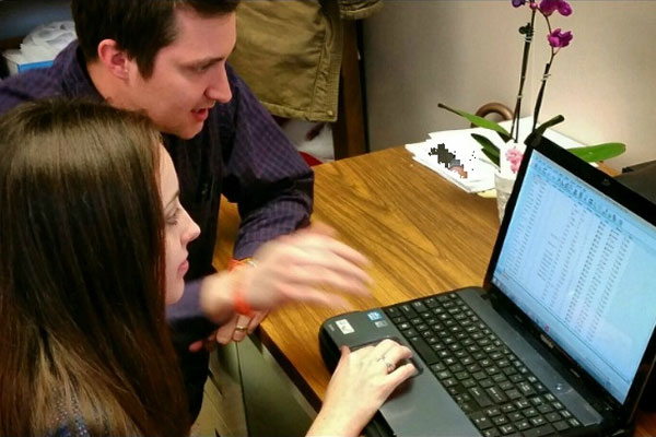 Graduate students looking at laptop