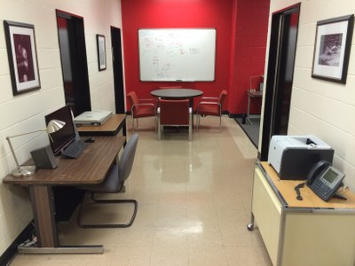 Lab area with desks, computer, and printer