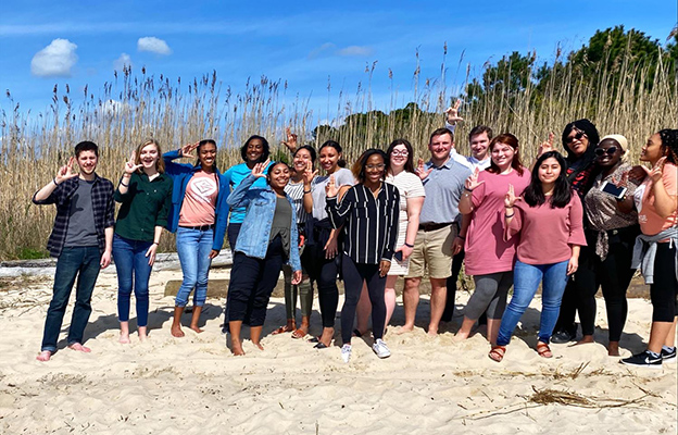 Baptist Campus Ministry students posing in the sand