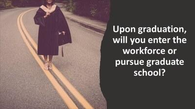 Image of graduate standing in road