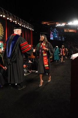 Student receiving diploma at Convocation May 2017