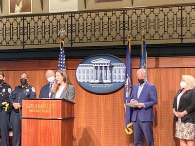 Susan Buchino speaking at press conference