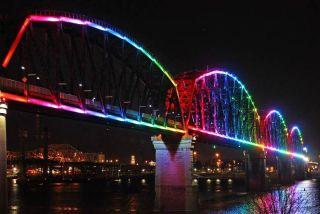 Big Four bridge lit up with multi-color lights