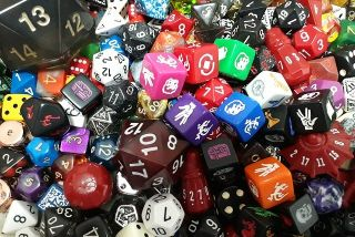 various sized and shaped dice