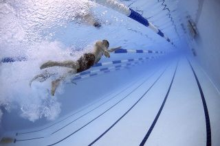 A swimmer doing laps photographed from underwater