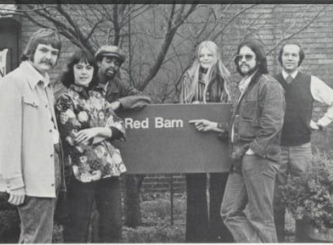 group of students posing with the then new Red Barn sign