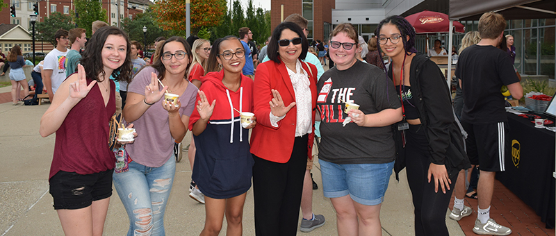 Students posing with Neeli Bendapudi at the President's Ice Cream Social