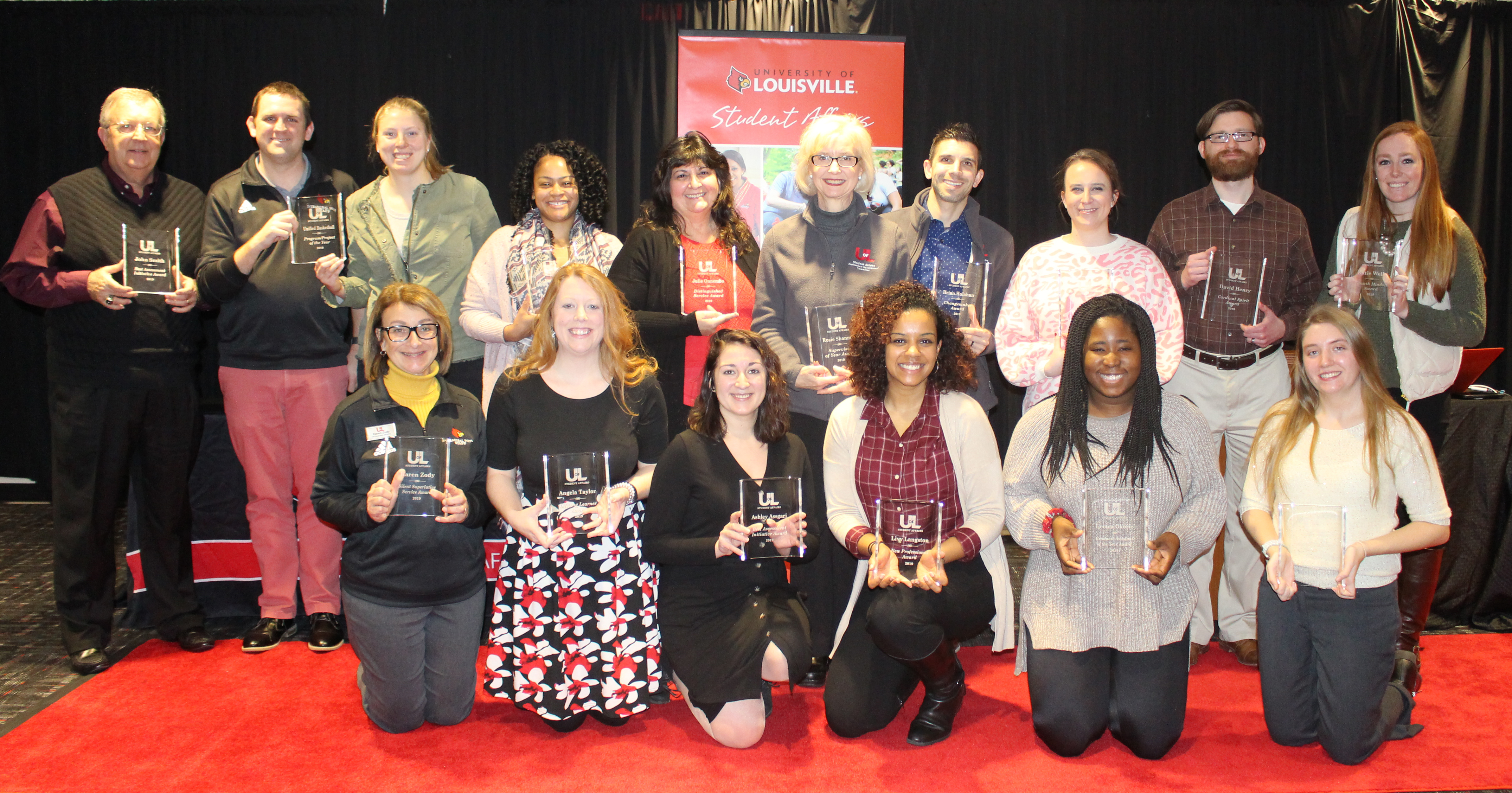 2019 award winners posing as a group with their trophies