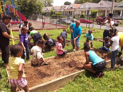 UofL Compost fills beds at New Directions Brandeis Housing Garden (Summer 2013)