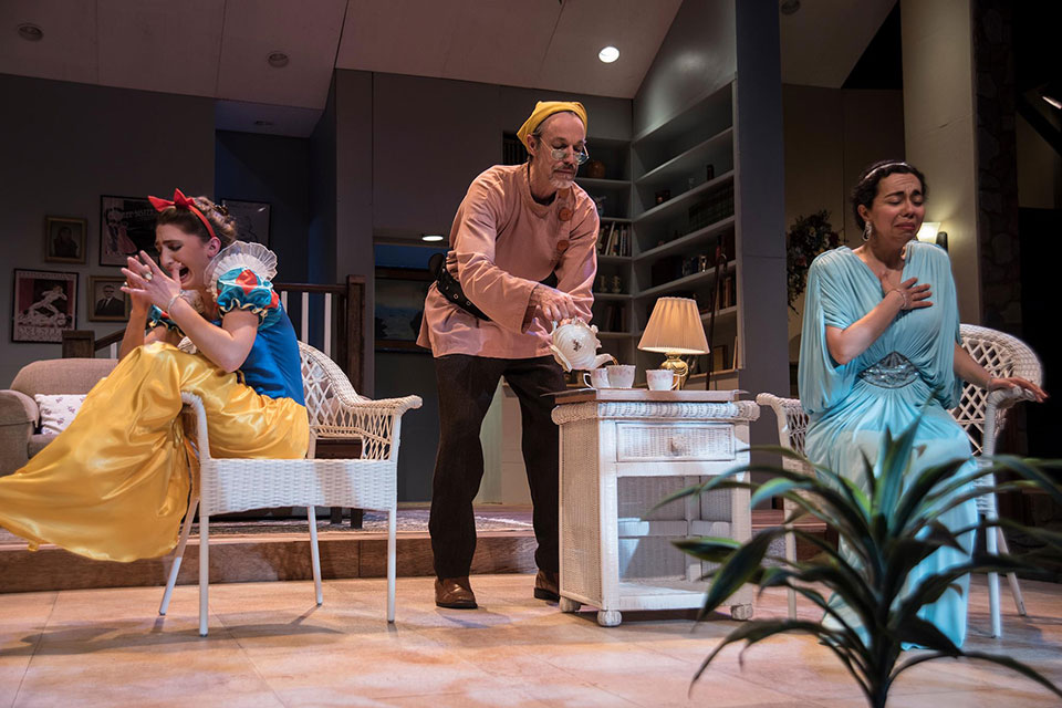 Three actors performing in a production of Christopher Durang's Vanya and Sonia and Masha and Spike