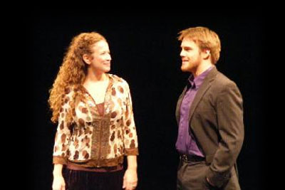 Two students speaking on stage