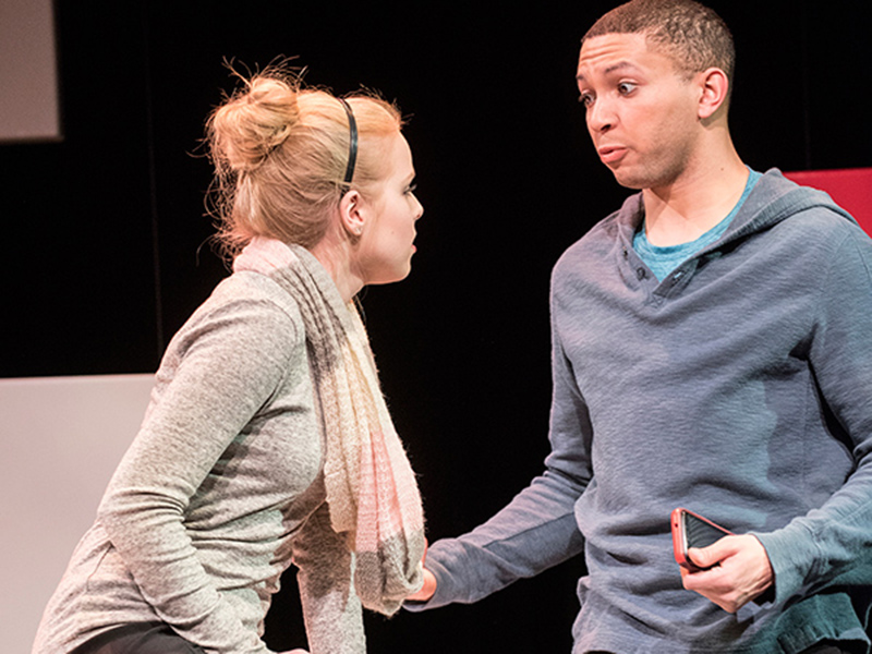 Baltimore production photo female actress and male actor engage together on stage