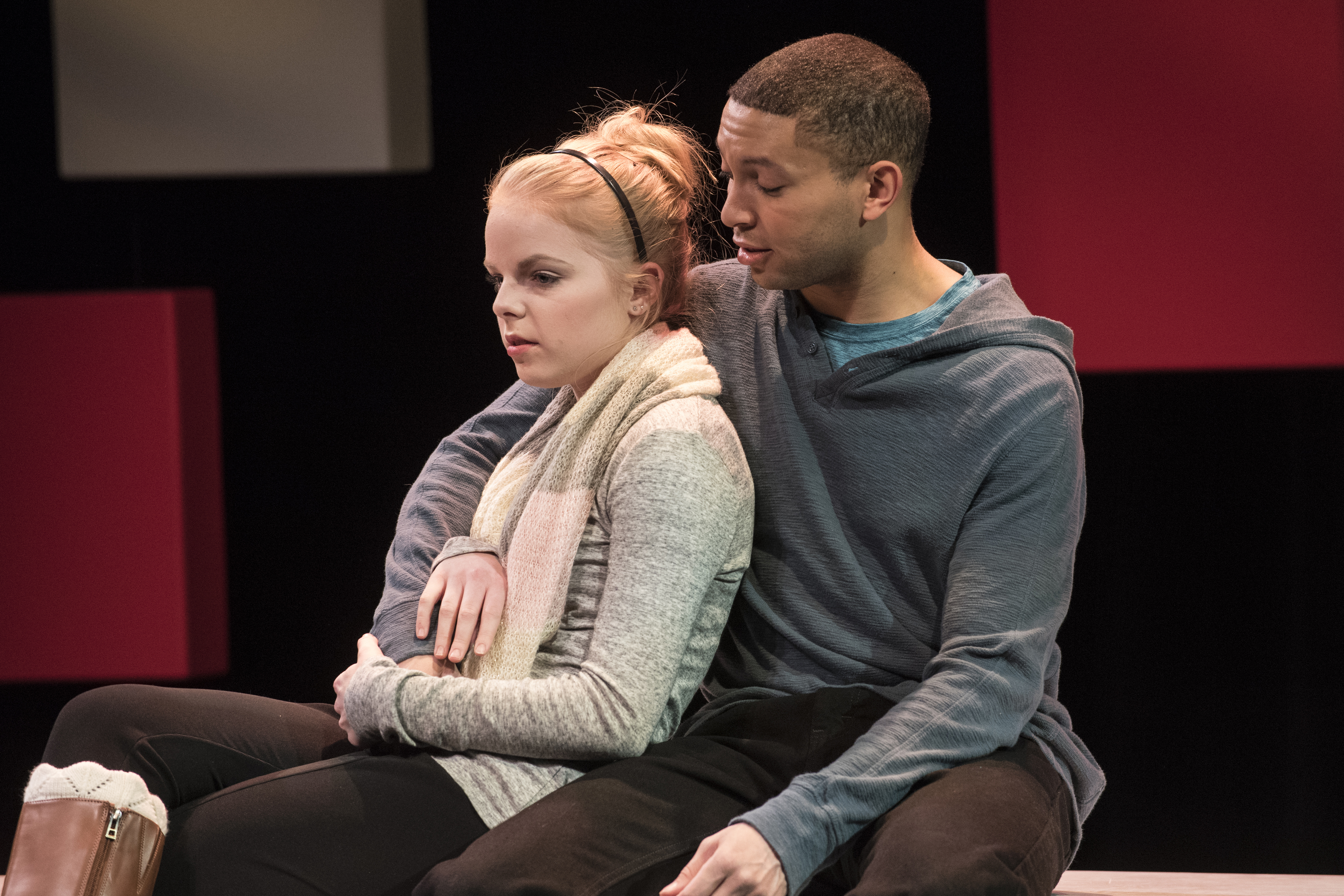 Baltimore production. Man with arm around woman