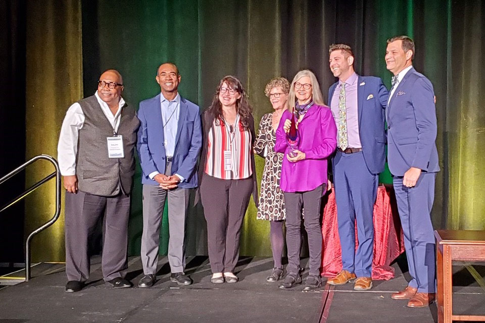 Cate Fosl and other project members receiving the W. K. Kellogg Foundation CommunityEngagement Scholarship Award in 2019
